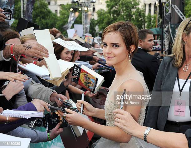 Actress Emma Watson signs autographs at the World Premiere of 'Harry Potter And The Deathly Hallows Part 2' in Trafalgar Square on July 7 2011 in...
