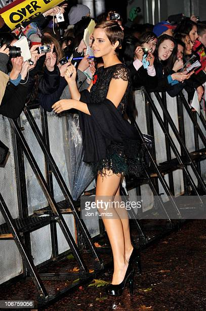 Actress Emma Watson signs autographs for fans at the world premiere of 'Harry Potter and The Deathly Hallows' at Odeon Leicester Square on November...