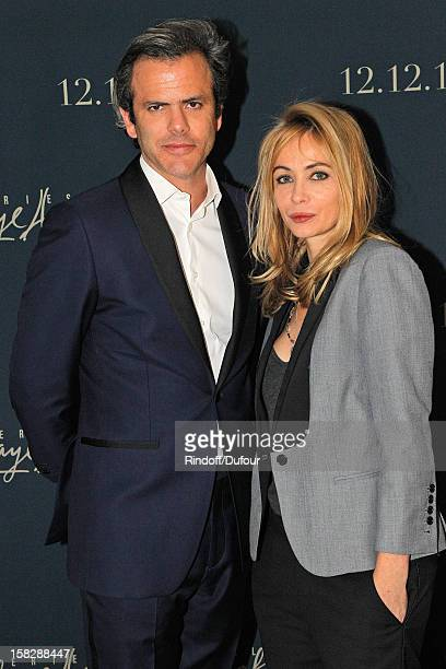 Actress Emmanuelle Beart and Guillaume Houze Director of Sponsorship at Galeries Lafayette attend the Galeries Lafayette 100th Anniversary Bal on...