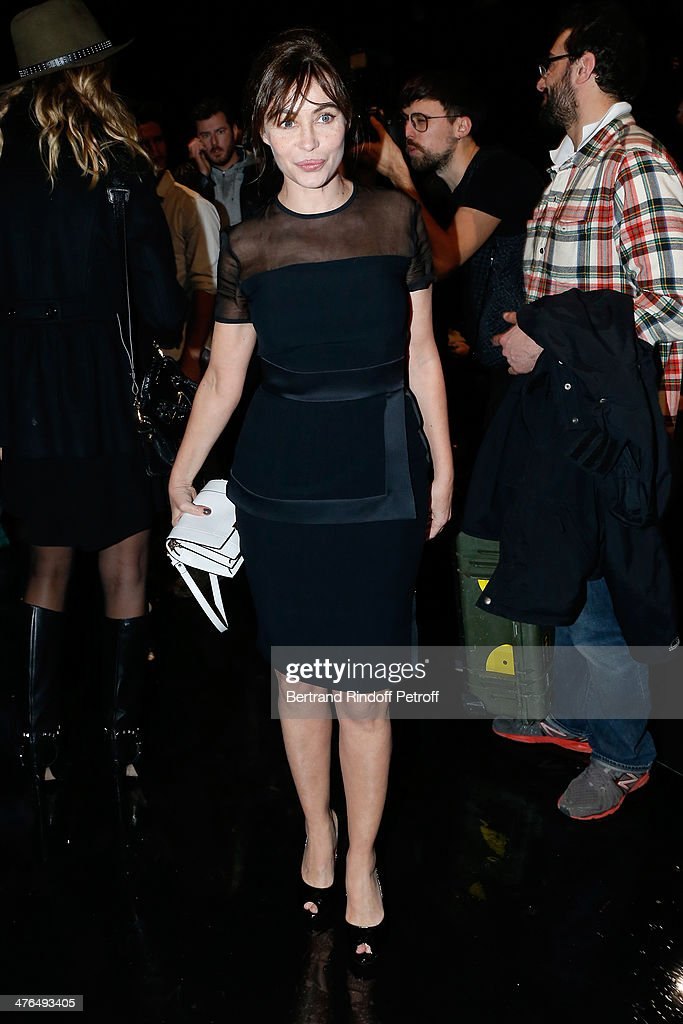 Actress Emmanuelle Beart (dressed in Elie Saab) attends the Elie Saab show as part of the Paris Fashion Week Womenswear Fall/Winter 2014-2015 on March 3, 2014 in Paris, France.