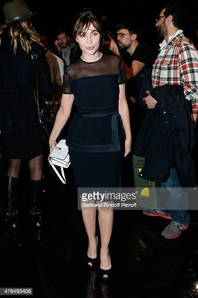 Actress Emmanuelle Beart attends the Elie Saab show as part of the Paris Fashion Week Womenswear Fall/Winter 20142015 on March 3 2014 in Paris France
