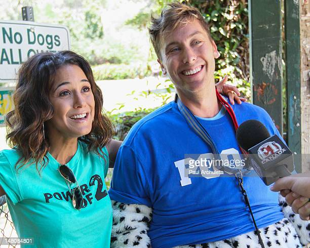 Actress Emmanuelle Chriqui defeats Lance Bass in a bet for the charity Initiative PowerOf2 at Runyon Canyon on July 9 2012 in Los Angeles California