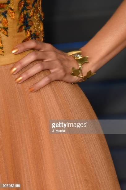 Actress Emmanuelle Chriqui jewelry detail attends the 2018 Vanity Fair Oscar Party hosted by Radhika Jones at the Wallis Annenberg Center for the...