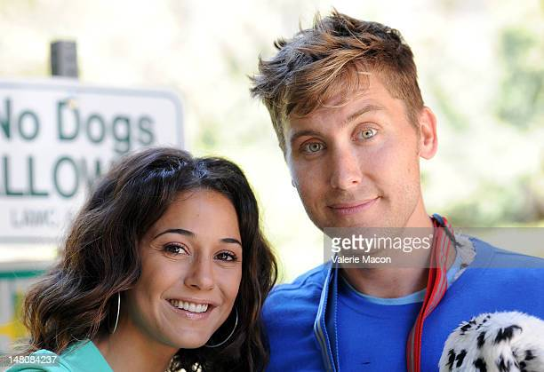 Actress Emmanuelle Chriqui walks actor Lance Bass dressed up as Poo Fu the dog in Runyon Canyon during The Power Of 2 Event on July 9 2012 in Los...