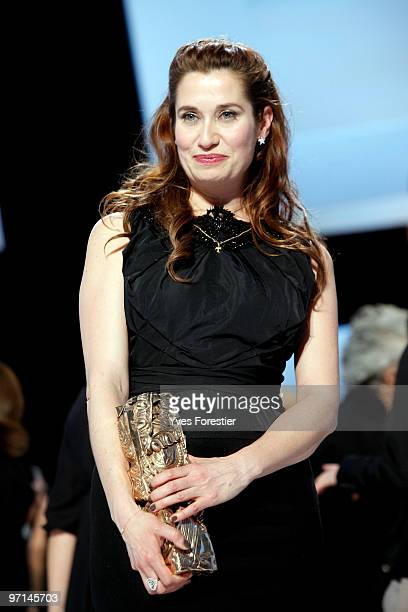 Actress Emmanuelle Devos poses with her award after the show at the 35th Cesar Film Awards held at the Theatre du Chatelet on February 27 2010 in...