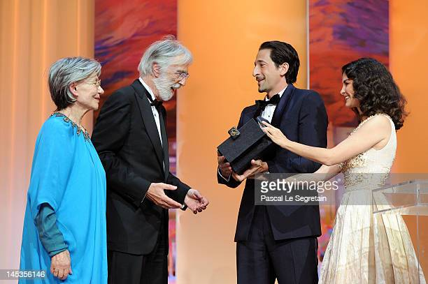 Actress Emmanuelle Riva looks on as director Michael Haneke receives the Palme D'Or for 'Amour' from actors Adrien Brody and Audrey Tautou onstage at...