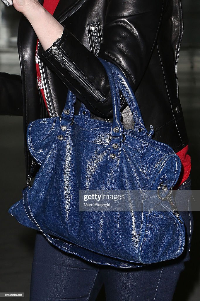 Actress Emmanuelle Seigner (handbag detail) is sighted at Nice airport after the 66th Annual Cannes Film Festival on May 27, 2013 in Nice, France.