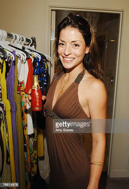 Actress Emmanuelle Vaugier holds a bottle of Piper Heidsieck champagne at the Star Lounge In Honor of Rolling Stone's 40th Anniversary at the Hard...