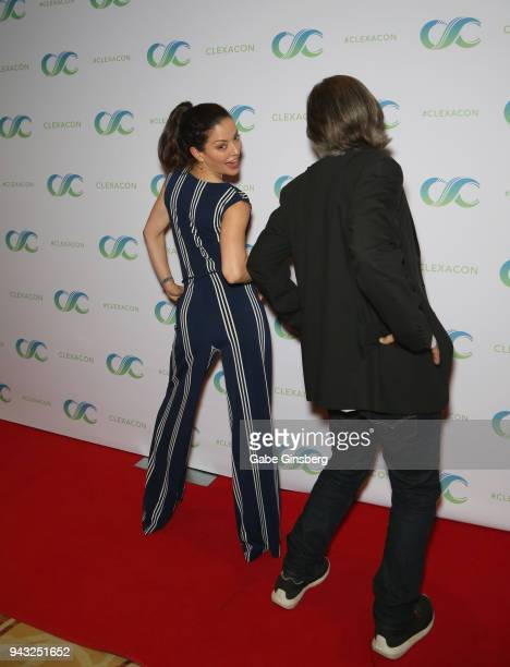 Actress Emmanuelle Vaugier reacts to producer Vince Calandra trying to pose like her during the Cocktails for Change fundraiser hosted by ClexaCon to...