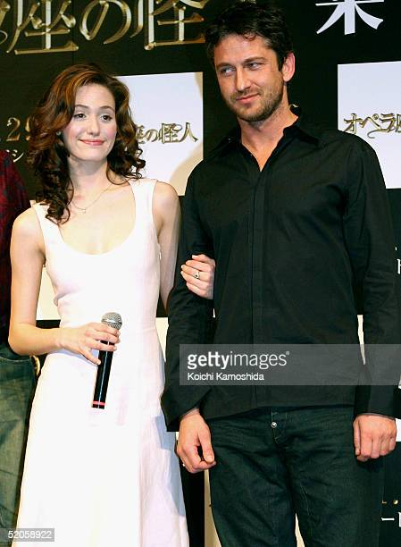 Actress Emmy Rossum and actors Gerard Butler attend a press conference to promote 'Phantom of the Opera' on January 25 2005 in Tokyo Japan The film...