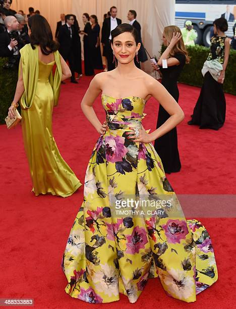 Actress Emmy Rossum arrives at the Costume Institute Benefit at The Metropolitan Museum of Art May 5 2014 in New York AFP PHOTO/Timothy A CLARY
