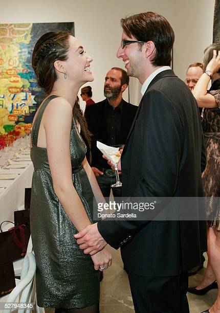 Actress Emmy Rossum chats with Justin Siegal at a dinner hosted by Vogue and Mulberry celebrating the work of Alexandra Grant on display at the 'Some...