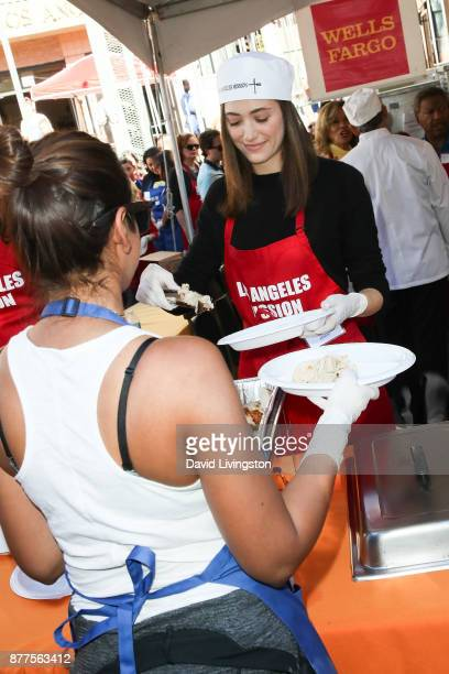 Actress Emmy Rossum is seen at the Los Angeles Mission Thanksgiving Meal for the homeless at the Los Angeles Mission on November 22 2017 in Los...