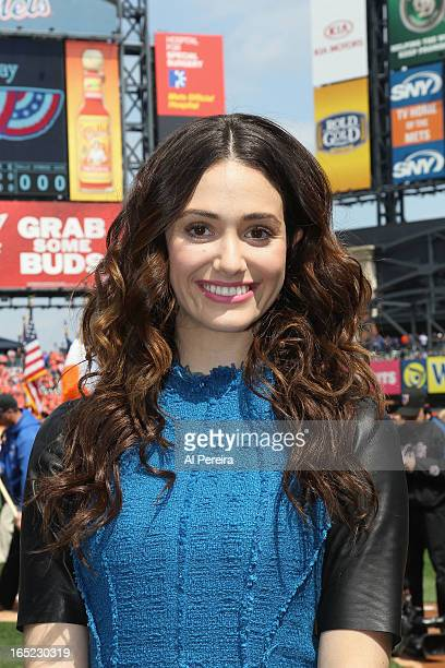 Actress Emmy Rossum performs the National Anthem with the Scholar's Academy School Chorus from The Rockaways when she attends the New York Mets'...