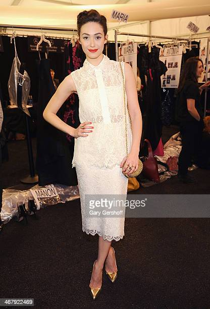 Actress Emmy Rossum poses backstage at the Monique Lhuillier show during MercedesBenz Fashion Week Fall 2014 at The Theatre at Lincoln Center on...