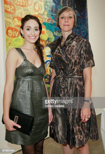 Actress Emmy Rossum poses with artist Alexandra Grant at a dinner hosted by Vogue and Mulberry celebrating the work of Alexandra Grant on display at...