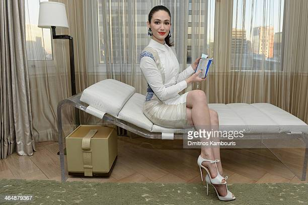 Actress Emmy Rossum prepares for the Bergdorf Goodman Restorsea MeetandGreet at London Sky Suite at The London on January 24 2014 in New York City