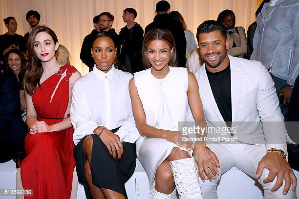 Actress Emmy Rossum Singer Kelly Rowland Singer Ciara and Quaterback of Seattle Seahawks Russell Wilson attend the Lanvin show as part of the Paris...