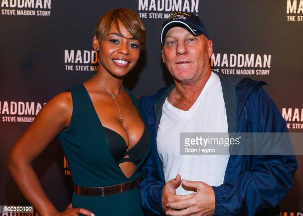 Actress Erica Peeples and shoe designer Steve Madden pose on red carpet during movie premiere at the Michigan Theater on October 11 2017 in Ann Arbor...
