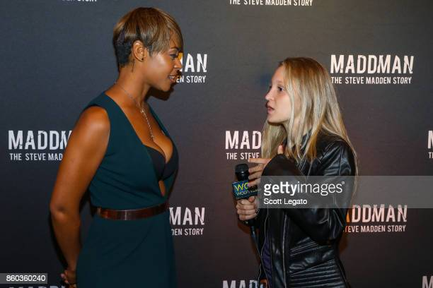 Actress Erica Peeples gets interviewed on red carpet during movie premiere at the Michigan Theater on October 11 2017 in Ann Arbor Michigan
