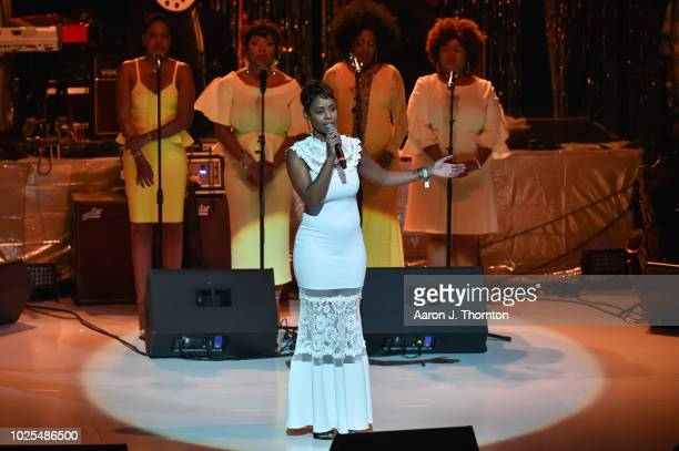 Actress Erica Peeples speaks on stage at a Tribute Concert to celebrate the life of songstress Aretha Franklin at Chene Park on August 30 2018 in...