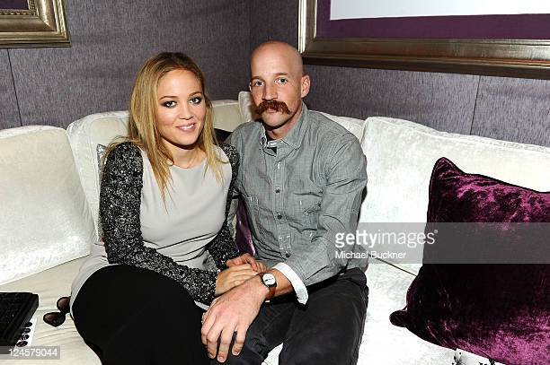 Actress Erika Christensen and Cole Maness backstage during MercedesBenz Fashion Week Spring 2012 at Lincoln Center on September 10 2011 in New York...