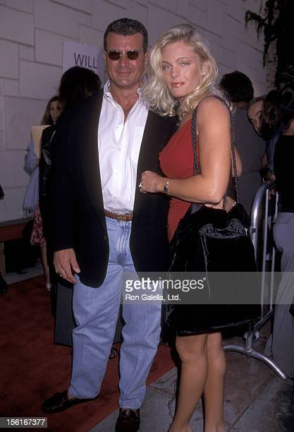 Actress Erika Eleniak and Philip Goglia attend the premiere of 'Love Stinks' on August 11 1999 at Mann Festival Theater in Westwood California