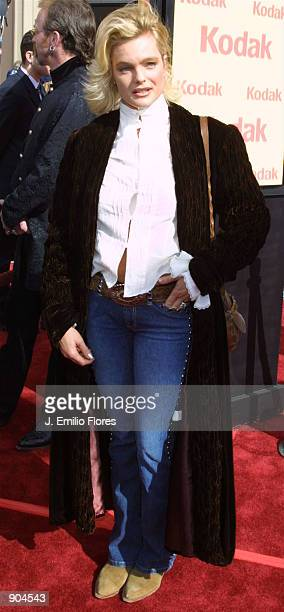 Actress Erika Eleniak attends the premiere of the 20th anniversary version of director Steven Spielberg's movie ET The ExtraTerrestrial March 16 2002...