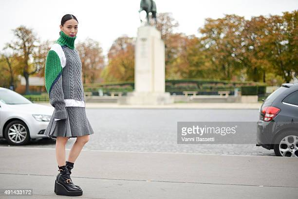 Actress Erika Toda poses wearing Sacai before the Sacai show at the Theatre National de Chaillot during Paris fashion week SS16 on October 5, 2015 in...