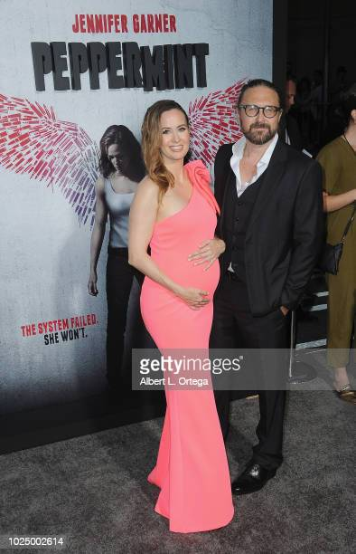 Actress Erin Carufel and director Pierre Morel arrive for the Premiere Of STX Entertainment's Peppermint held at Stadium 14 on August 28 2018 in Los...