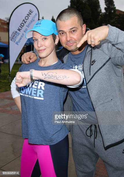 Actress Erin Cummings and Former MLB Player Nick Swisher attend the Power Of Tower run/walk at UCLA on March 11 2018 in Los Angeles California