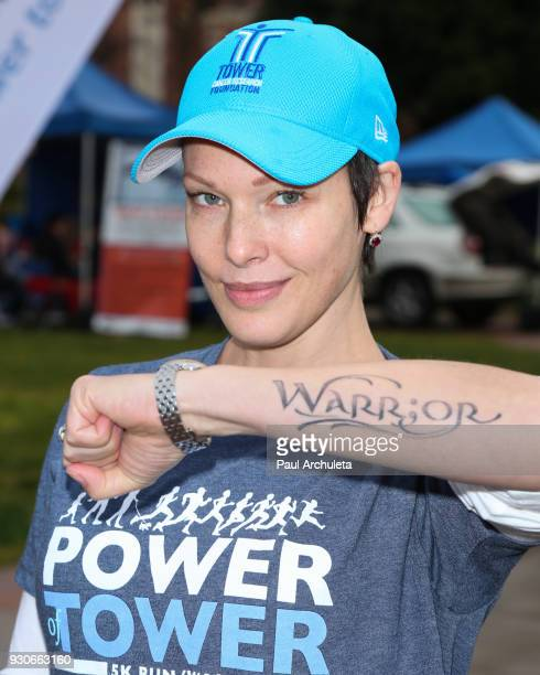 Actress Erin Cummings Tattoo Detail attends the Power Of Tower run/walk at UCLA on March 11 2018 in Los Angeles California