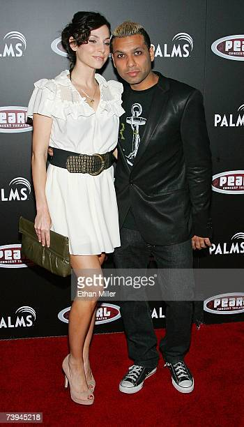 Actress Erin Lokitz and her boyfriend No Doubt bassist Tony Kanal arrive at a Gwen Stefani concert serving as the grand opening of The Pearl concert...