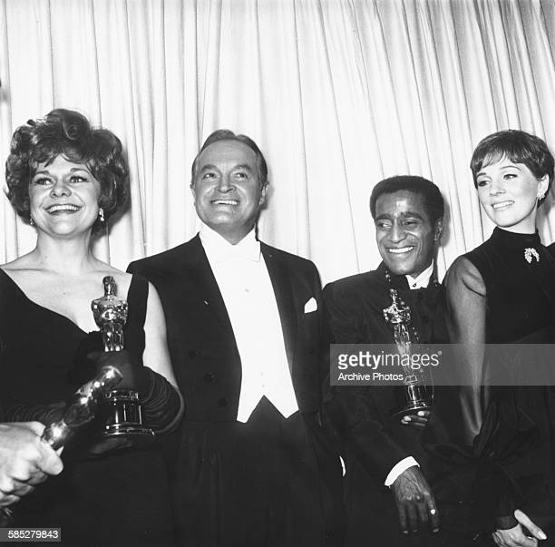 Actress Estelle Parsons holding her Best Supporting Actress Oscar for the film 'Bonnie and Clyde' with host Bob Hope Sammy Davis Jr accepting an...