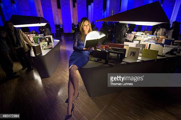Actress Esther Schweins poses with a lamp in form of a book at the exhibition of the guest country Indonesia during the opening ceremony of the 2015...