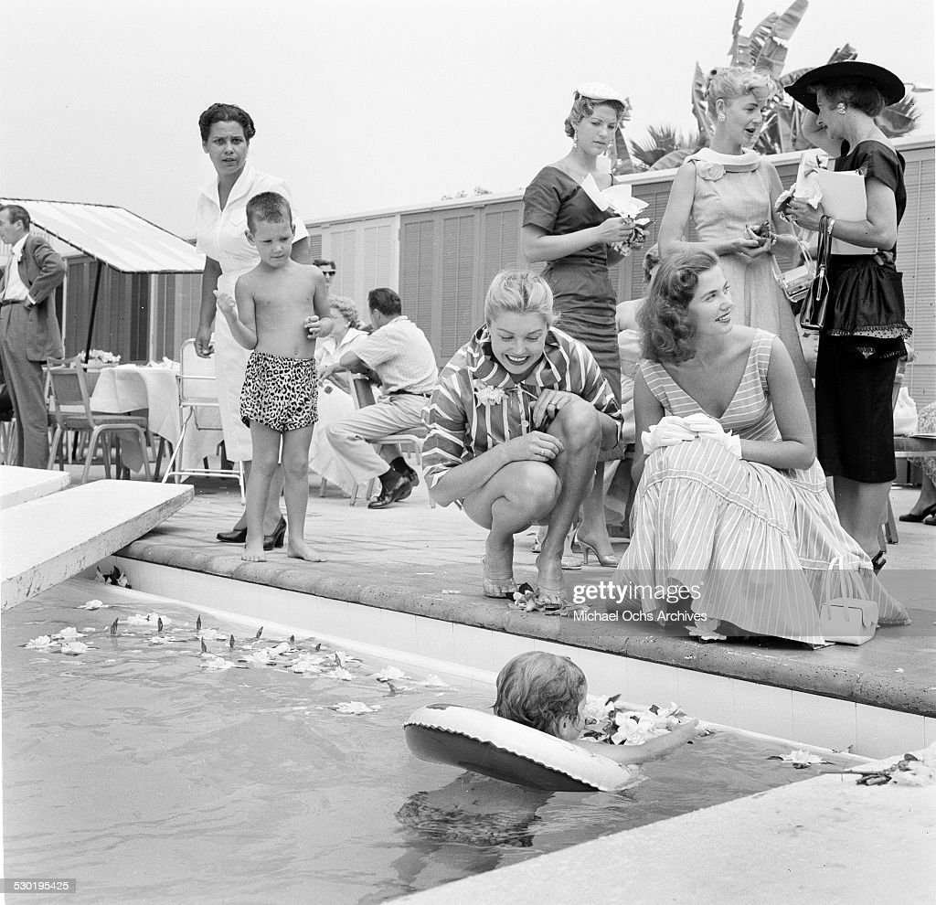 Actress Esther Williams is pool side watches children swim, during ...