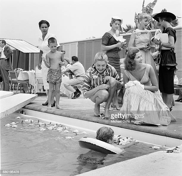 Actress Esther Williams is pool side watches children swim during the opening day of the Esther Williams Swim School at the Hilton Hotel in Los...