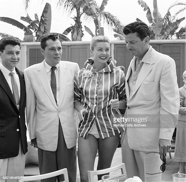 Actress Esther Williams poses pool side during the opening day of the Esther Williams Swim School at the Hilton Hotel in Los AngelesCA