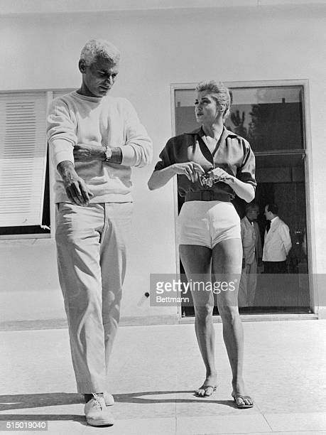 Actress Esther Williams takes a stroll with fellow actor Jeff Chandler after the day's work is done and they head for their dressing room