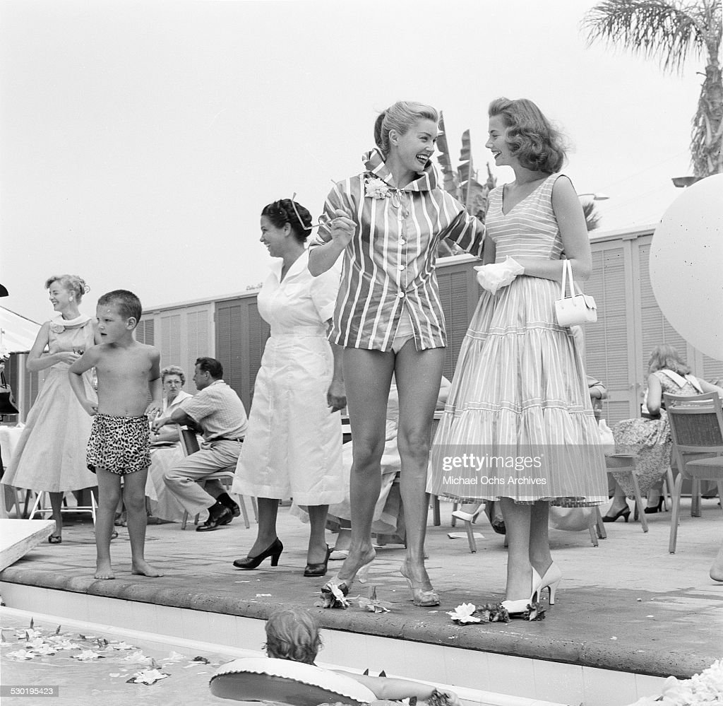 Actress Esther Williams talks with a parent pool side ...