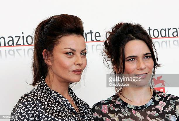 Actress Eva Grimaldi and Italian actress Silvia De Santis pose at the Photocall for out of competition film The Fine Art of Love Mine Ha Ha at the...