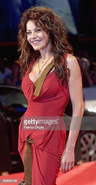Actress Eva Grimaldi arrives at the premiere of out of competition film The Fine Art of Love Mine Ha Ha at the Palazzo del Casino on the first day of...