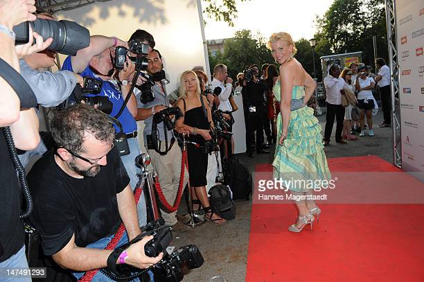 Actress Eva Habermann poses for the photographers during the 'Tele 5 Director's Cut' during the Munich Film Festival at the Praterinsel on June 30...