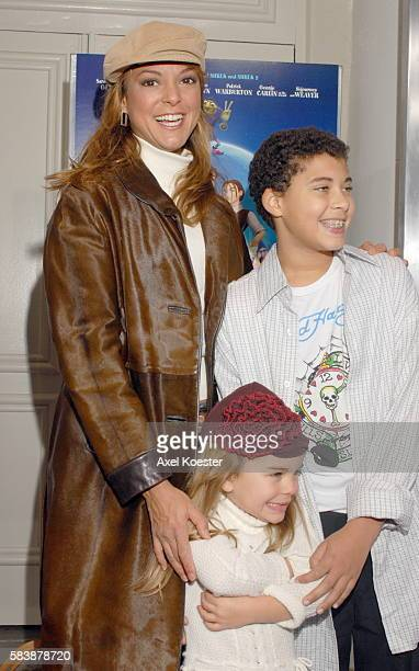 Actress Eva LaRue and family arrive at the Los Angeles premiere of the movie 'Happily N'Ever After' at Mann's Festival Theater in Westwood