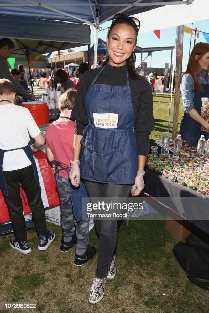 Actress Eva LaRue attends Celebrity Friends Volunteer with Feeding America at Para Los Niños' Felices Fiestas Celebration at Para Los Ninos on...