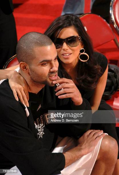 Actress Eva Longoria and her fiance Tony Parker of the San Antonio Spurs sit courtside before the Haier Shooting Stars at NBA AllStar Weekend at the...