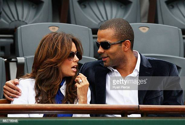 Actress Eva Longoria and her husband NBA Basketball player Tony Parker watch the action during the Men's Singles Final match Robin Soderling of...