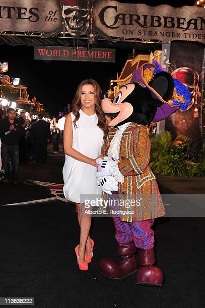 Actress Eva Longoria and Mickey Mouse arrive at the world premiere of 'Pirates Of The Caribbean On Stranger Tides' at Disneyland on May 7 2011 in...