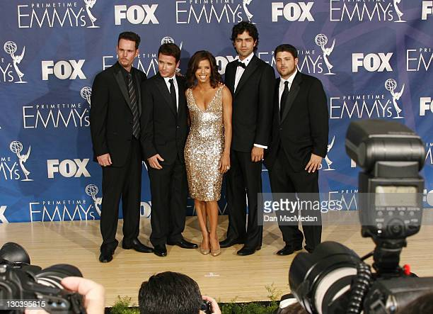 Actress Eva Longoria and the cast of Entourage Kevin Dillon Kevin Connolly Adrian Grenier and Jerry Ferrara pose in the pressroom during the 59th...