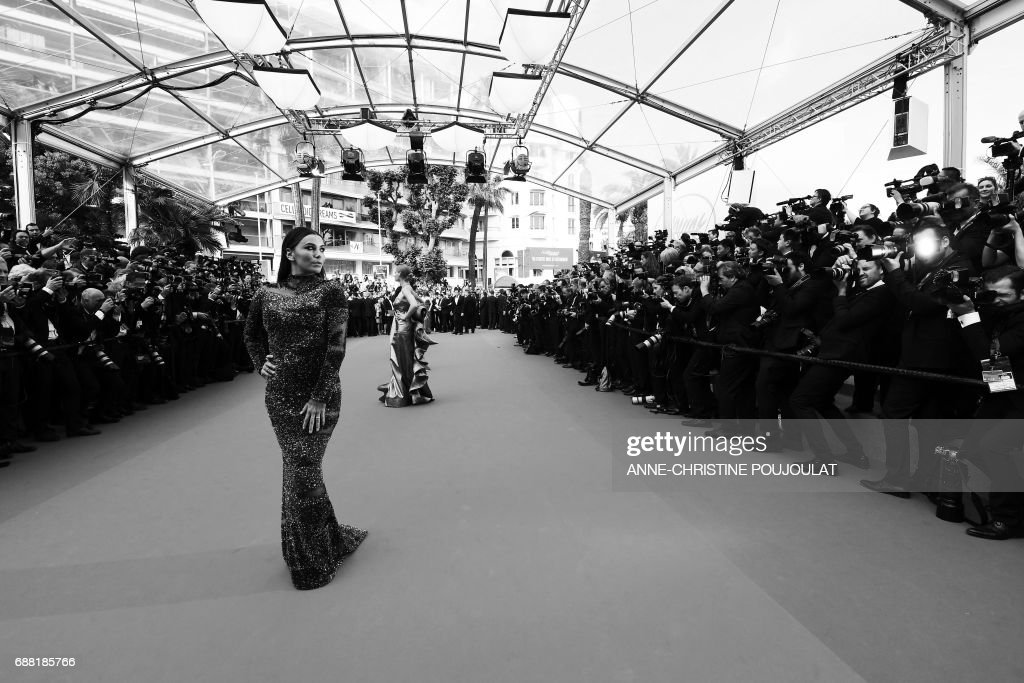 US actress Eva Longoria arrives on May 23, 2017 for the '70th Anniversary' ceremony of the Cannes Film Festival in Cannes, southern France. / AFP PHOTO / Anne-Christine POUJOULAT